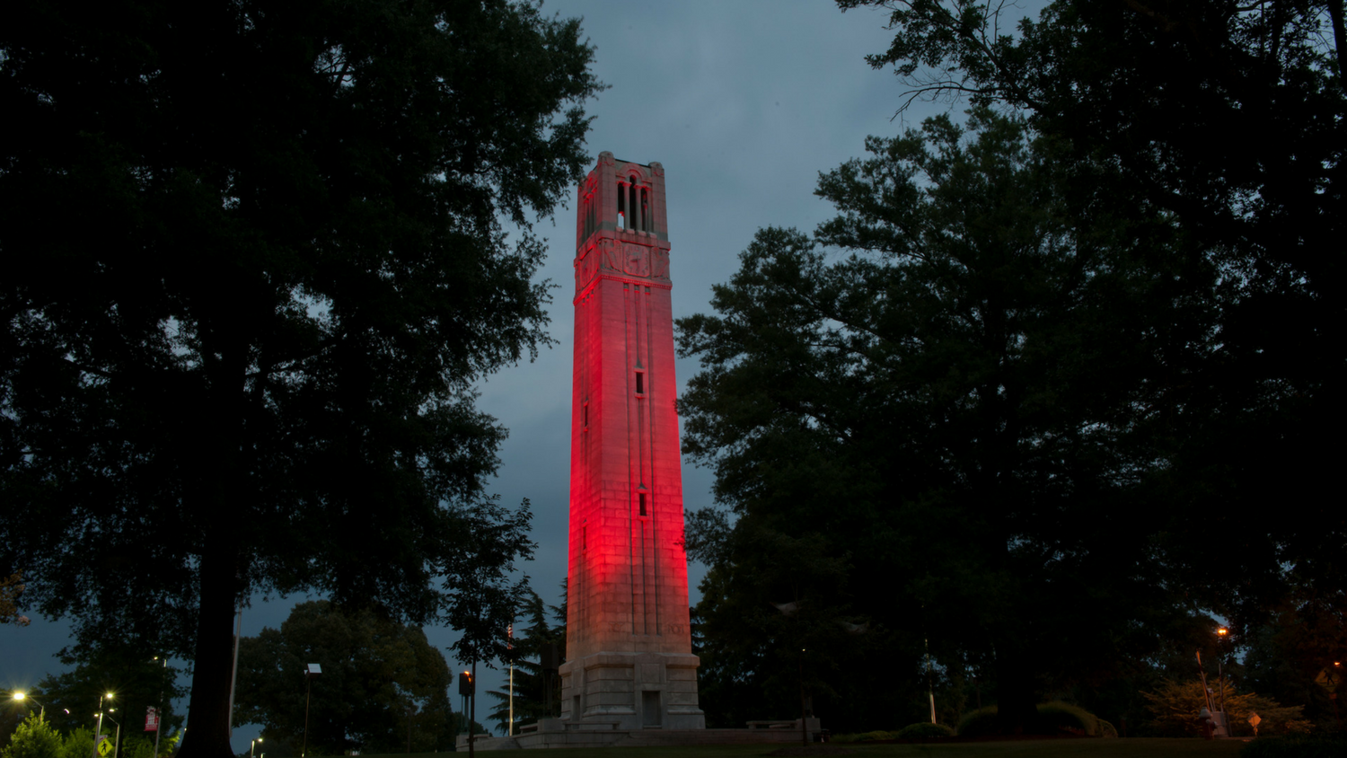 Bell tower at dusk lit with red light