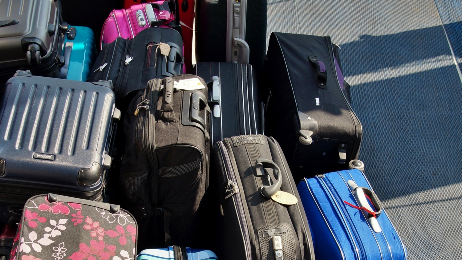 Pile of suitcases on ground