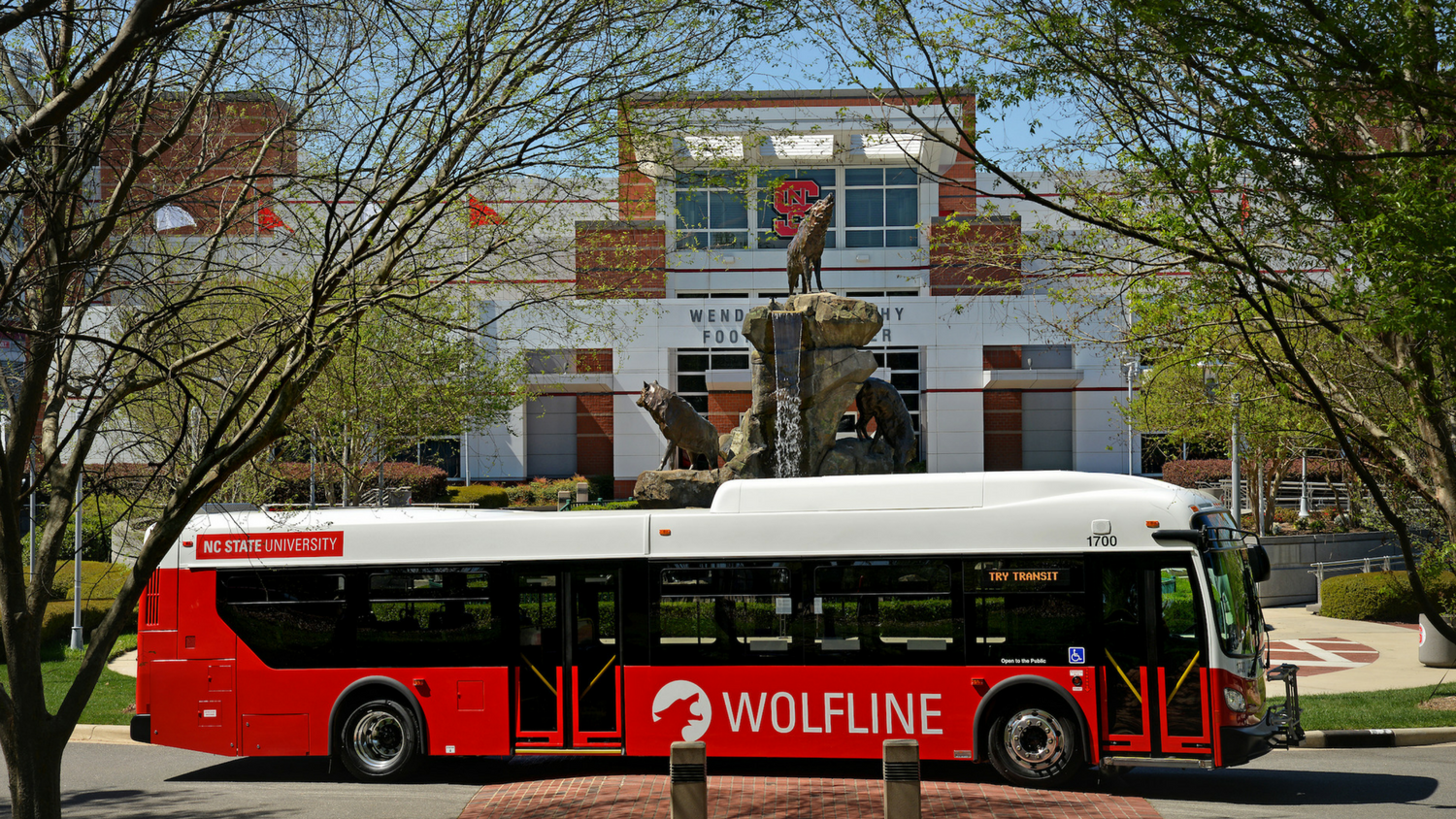 Wolfline bus with Wendell H. Murphy Football Center in background