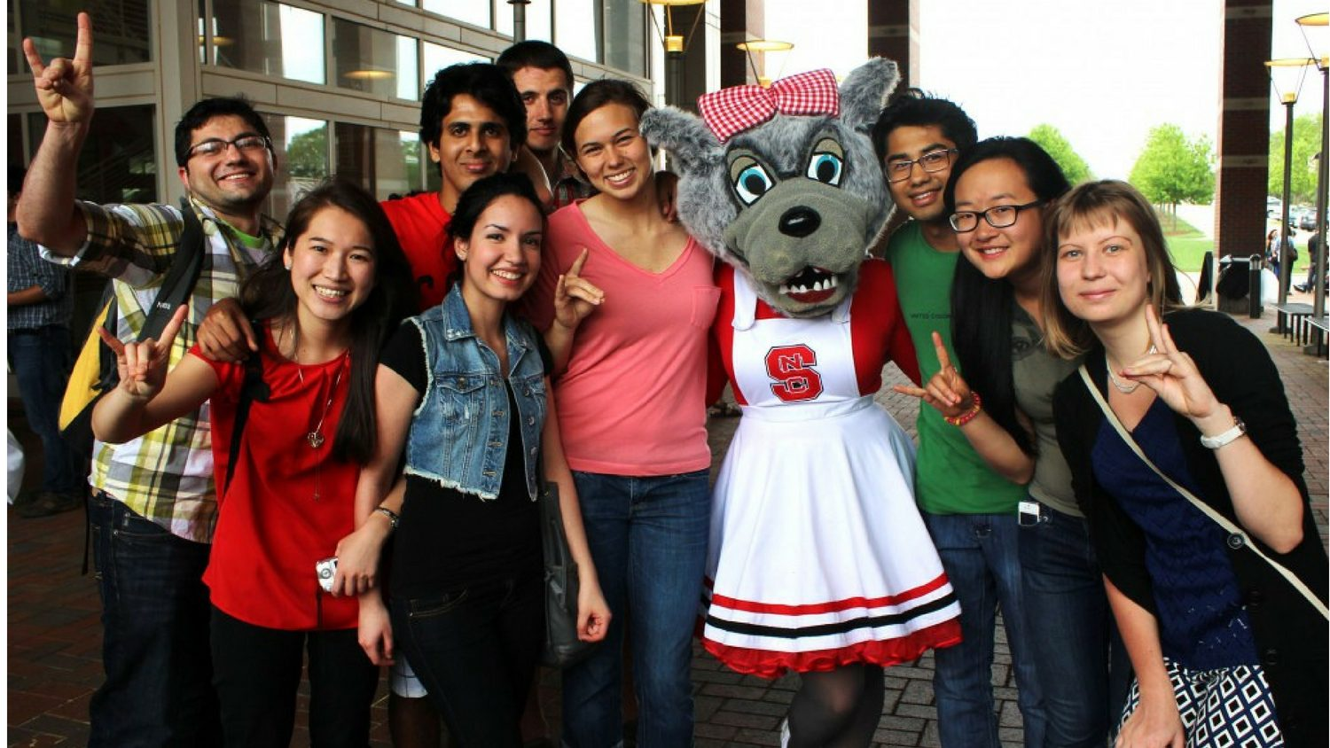 International students with Mrs. Wuf mascot